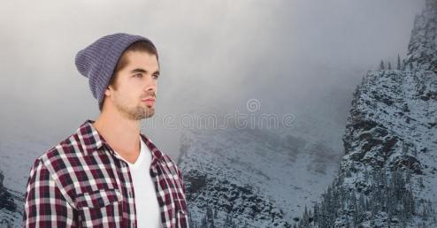 young-hipster-wearing-knit-hat-against-snowcapped-mountains-digital-composite-92885255